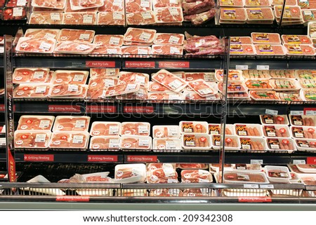 TORONTO, CANADA - MAY 06, 2014: Meat and poultry section in a supermarket. Meat industry is the largest sector of the North America food manufacturing industry. - stock photo