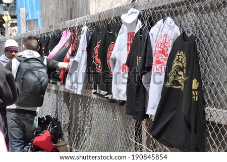 Toronto, Canada - May 4, 2014: Merchandises bearing the logo of Toronto Raptors are being sold in the street during the  rubber match  in playoffs between Raptors and Brooklyn Nets. Nets won 104-103.  - stock photo