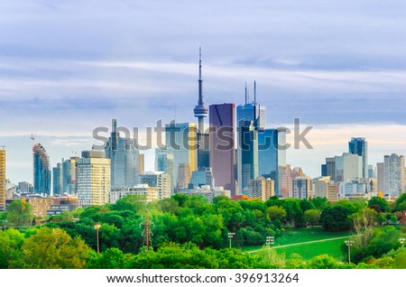 Toronto, Canada - 27 may 2013: Skyline of downtown Toronto, Canada, with Cn Tower in the spring from Riverdale Park East - stock photo