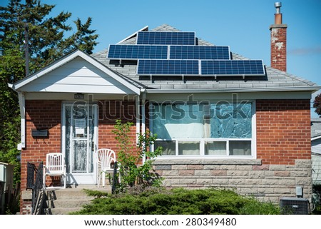 TORONTO,CANADA-MAY 20,2015: Solar energy panels in private house, practical  use of solar energy is becoming more popular in Canada, some houses and transit signals are using the technology  - stock photo