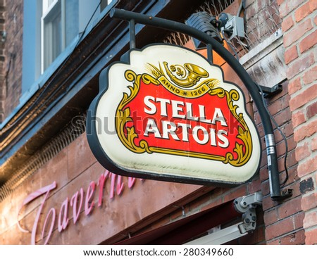 TORONTO,CANADA-MAY 20,2015: Stella Artois advertisement sign in Little Italy, Stella Artois informally called Stella, is a pilsner beer which has been brewed in Leuven, Belgium, since 1926 - stock photo
