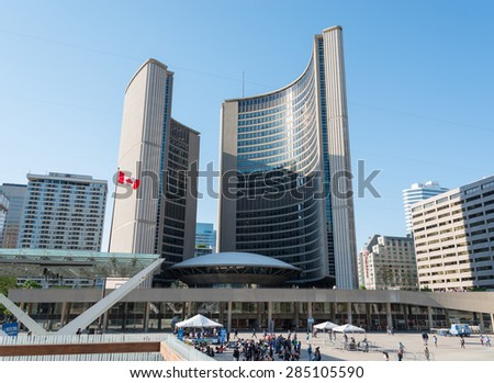 TORONTO,CANADA-MAY 12,2015: The Modernist architecture of the New City Hall in Nathan Phillips Square in day light afternoon. The building seats the Mayor and Councilors of the municipal government - stock photo