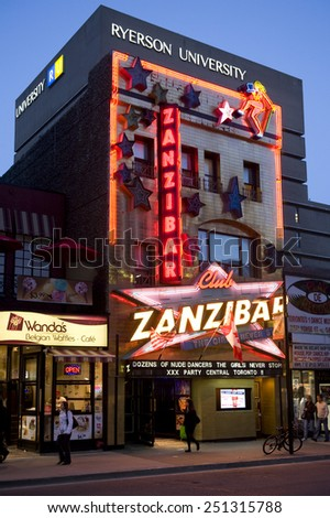 TORONTO, CANADA - MAY 5, 2011:  The Zanzibar Tavern is a landmark in Toronto that celebrated its 50th anniversary in 2010.  It is a popular strip bar located on the famous Yonge Street. - stock photo