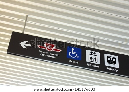 TORONTO, CANADA - MAY 25: TTC subway sign on May 25, 2013 in downtown Toronto, Ontario, Canada. Directional sign showing TTC subway station. - stock photo