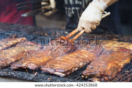 TORONTO,CANADA-MAY 22,2016: Yonge-Dundas Square Rib Fest and BBQ Bash: Traditional meat lovers festival featuring the best teams from Canada and the U.S. - stock photo