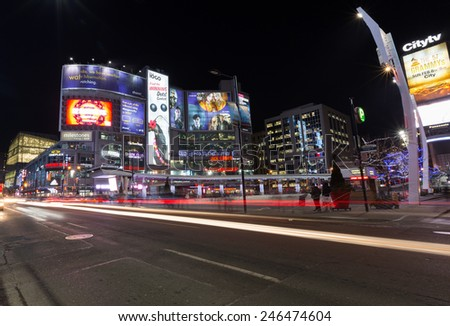 TORONTO, CANADA - 22ND JANUARY 2015: Yonge Dundas Square at night showing the blur of people and buildings - stock photo