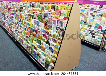 TORONTO, CANADA - NOVEMBER 30, 2013: Greeting cards on display in a store. Hallmark Cards and American Greetings are the largest producers of greeting cards in the world. - stock photo