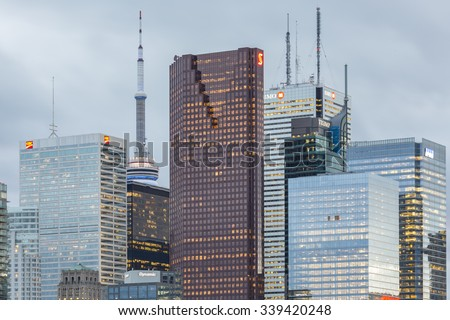 TORONTO, CANADA - NOVEMBER 14, 2015: Rooftops of  skyscrapers , CN Tower and high-rise  office buildings in Financial District of Toronto - stock photo