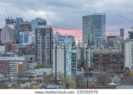 TORONTO, CANADA - NOVEMBER 14, 2015: Skyscrapers and new high-rise building sites in Downtown Toronto at sunset. - stock photo