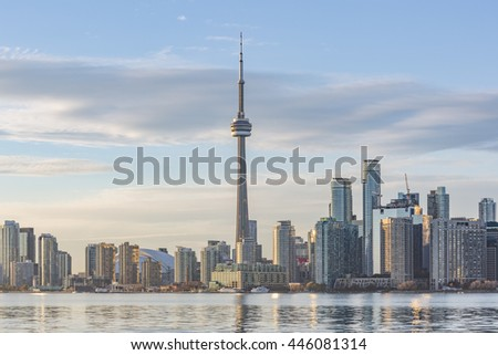 TORONTO, CANADA - NOVEMBER 3, 2015:Toronto Skyline with the CN Tower apex at sunset