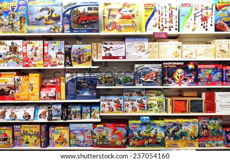 TORONTO, CANADA - NOVEMBER 02, 2014: Variety of construction toys on shelves in a store. The Lego Group is the major manufacturer of construction toys in the world.