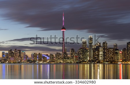 TORONTO, CANADA - NOVEMBER 02, 2015: View of Downtown Toronto skyline with the CN Tower  and the Financial District  skyscrapers - illuminated after sunset. - stock photo