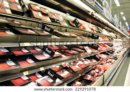 TORONTO, CANADA - OCTOBER 31, 2014: Meat and poultry products in a supermarket. Meat industry is the largest sector of the North America food manufacturing industry. - stock photo