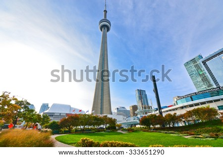 Toronto, Canada - October 15: View of CN Tower from a park in Toronto on October 15, 2013.  - stock photo