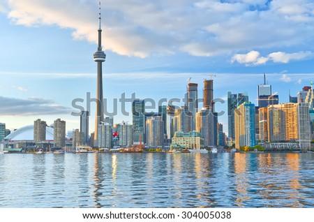 Toronto, Canada - October 14, 2013: View of Toronto skyline at sunset from Toronto Island, Ontario, Canada on October 14, 2013.  - stock photo