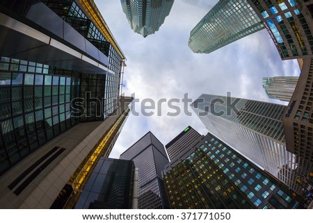 TORONTO CANADA 16-10-2015:Office buildings stretch up to the blue sky in the financial district in downtown. Toronto has prominent buildings in a variety of styles by many famous architects. - stock photo