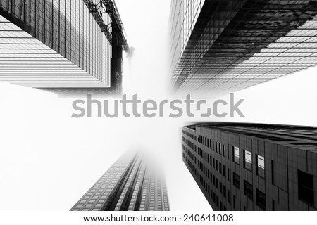 TORONTO, CANADA - 24TH DECEMBER 2014: A low view of skyscrapers in downtown Toronto during a day when the clouds and fog is Low-lying - stock photo