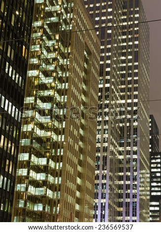 TORONTO, CANADA - 9TH DECEMBER 2014: Part of modern office buildings in downtown Toronto at night