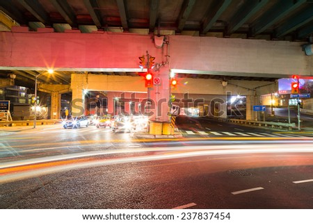 TORONTO, CANADA - 9TH DECEMBER 2014: Traffic on an underpass in Toronto at night - stock photo