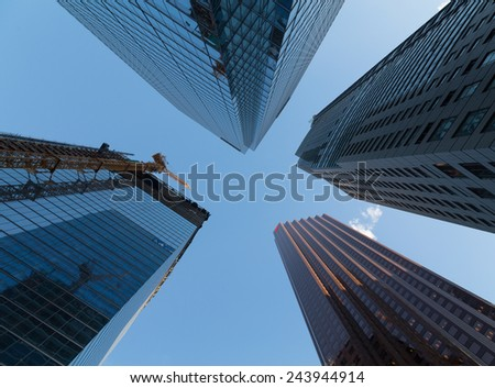 TORONTO, CANADA - 13TH JANUARY 2015: An upwards view of buildings in downtown Toronto during the day - stock photo