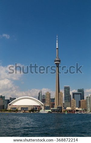 TORONTO, CANADA - 27TH JULY 2014: The CN Tower and Rogers Centre from Lake Ontario during the day