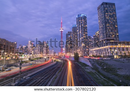 TORONTO, CANADA - 25TH JUNE 2015: A view of Toronto Downtown showing part of the railway and  light trails from Trains. - stock photo