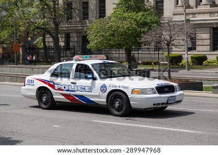 TORONTO, CANADA - 24TH MAY 2015: The outside of a Toronto Police Car during the day. - stock photo