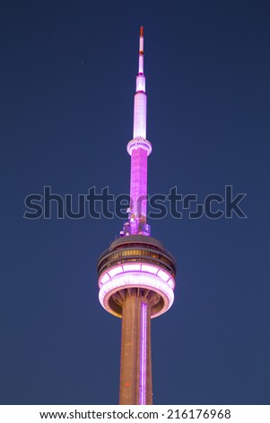 TORONTO, CANADA - 7TH SEPTEMBER 2014: The top of the CN Tower in downtown Toronto at night showing it light up - stock photo