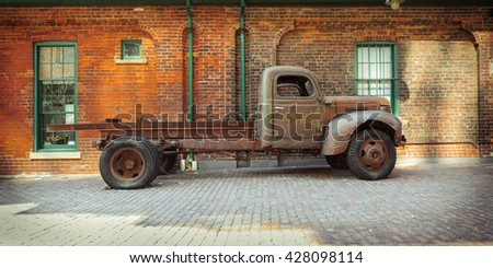 Toronto city, Ontario, Canada, May 22, 2016, beautiful inviting Toronto city landscape view with old vintage classic retro truck parked against brick building at Toronto distillery historic district