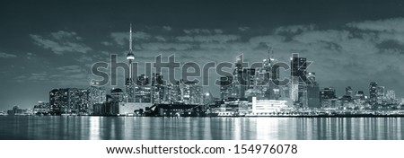 Toronto cityscape panorama at night over lake in black and white. - stock photo