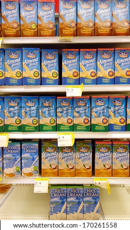 TORONTO - DECEMBER 14: Almond milk selection in a supermarket on December 14, 2013 in Toronto. Unlike animal milk, almond milk contains neither cholesterol nor lactose. - stock photo