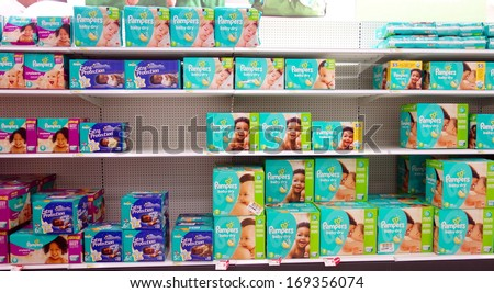 TORONTO - DECEMBER 14: Diapers boxes in a supermarket on December 14, 2013 in Toronto, Canada. An estimated 27.4 billion disposable diapers are used each year in the US. - stock photo