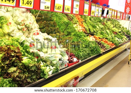 TORONTO - DECEMBER 18: Variety of green vegetables in a grocery store. Consumption of green vegetables has increased in recent years, as more people try to follow a healthy lifestyle. - stock photo