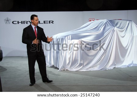 TORONTO, FEBRUARY 11: A Chrysler representative speaking at the unveiling of the new Dodge Ram Heavy Duty Chassis Cab pick-up truck at the Canadian International AutoShow 2009 held in Tornoto, Canada on Feb. 11, 2009. - stock photo