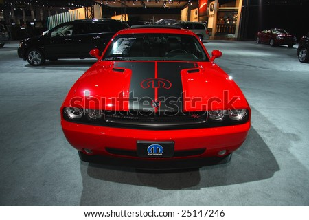 TORONTO, FEBRUARY 11: A Dodge Challenger was on exhibition at the Chrysler display during the Canadian International AutoShow 2009.  More than 1,000 cars and trucks were on display at this show held Feb. 11, 2009 in Toronto, Canada. - stock photo