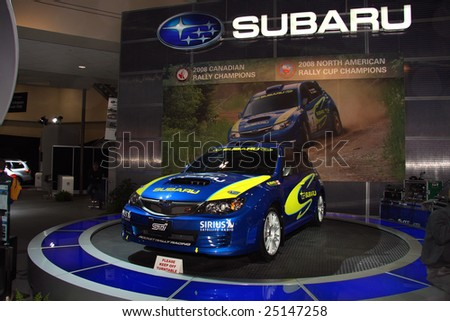 TORONTO, FEBRUARY 11: A Subaru rally was on  display at the Canadian International AutoShow 2009 held Feb. 11, 2009 in Toronto, Canada.  Subaru won the 2008 Canadian and North American rally sport championships. - stock photo