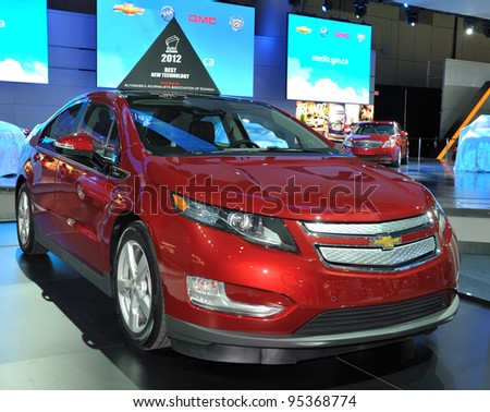 TORONTO-FEBRUARY 16: AJAC's 2012 Best New Technology awarded Chevrolet Volt  on display at the 2012 Canadian International Auto Show on February 16, 2012 in Toronto, Canada. - stock photo