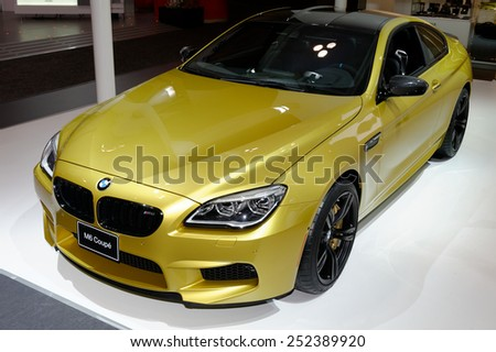 TORONTO-FEBRUARY 12: at the 2015 Canadian International Auto Show BMW M6 Coupe is a flawless balance of power, efficiency, comfort and luxury with a remarkable 4.4-litre M turbocharged V8 engine - stock photo