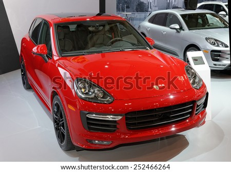 TORONTO-FEBRUARY 12: at the 2015 Canadian International Auto Show Porsche Cayenne GTS has a 0 to 100 km/h (62 mph) time of 5.7 seconds   on February 12, 2015 in Toronto  - stock photo