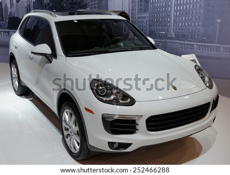 TORONTO-FEBRUARY 12: at the 2015 Canadian International Auto Show  Porsche Cayenne S E-Hybrid is the third production PHEV for the German automaker with 95-horsepower synchronous electric motor - stock photo