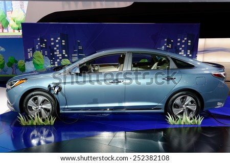 TORONTO-FEBRUARY 12: at the 2015 Canadian International Auto Show  Sonata Hybrid Plug-in can go for 22 miles (35.4 km) using just battery power alone  on February 12, 2015 in Toronto  - stock photo