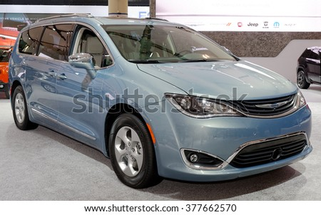 TORONTO-FEBRUARY 12: at the 2016 Canadian International AutoShow, all new Chrysler Pacifica comes with nearly 40 new minivan-first features and unprecedented levels of functionality and technology - stock photo