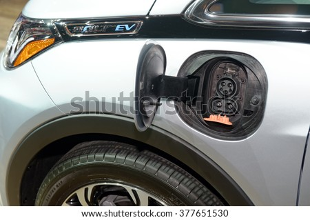 TORONTO-FEBRUARY 12: at the 2016 Canadian International AutoShow. Chevrolet Bolt charging connector - stock photo