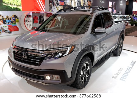 TORONTO-FEBRUARY 12: at the 2016 Canadian International AutoShow, 2017 Honda Ridgeline features an ACE body structure and industry first 400-watt AC power inverter for a truck-bed audio system - stock photo