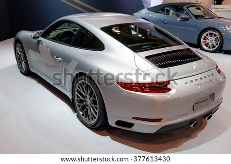 TORONTO-FEBRUARY 12: at the 2016 Canadian International AutoShow. The new Porsche 911 Carrera S now rates 420 horses, romp to 100 km/h in 4.1 seconds and drives the rear or all four wheels  - stock photo