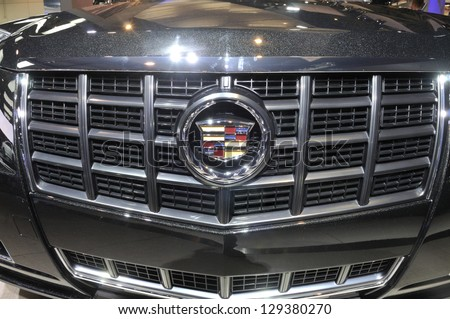 TORONTO-FEBRUARY 22: Close up of a Cadillac XTS Sedan bonnet during the 40th International Auto Show on February 22, 2013 in Toronto, Canada. - stock photo