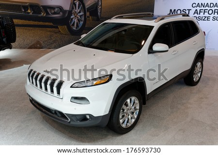 TORONTO-FEBRUARY 14:Jeep Cherokee voted Best NEW SUV under $35,000 and The Canadian SUV of the Year  at the 2014 Canadian International Auto Show on February 14, 2014 in Toronto           - stock photo