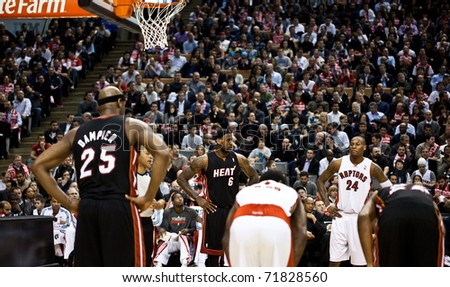 TORONTO - FEBRUARY 16: LeBron James No. 6 participates in an NBA basketball game at the Air Canada Centre on February 16, 2011 in Toronto, Canada.  The Miami Heat beat the Toronto Raptors 103-95. - stock photo