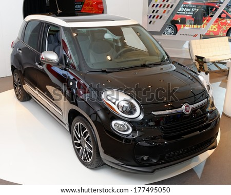 TORONTO-FEBRUARY 14: The all New Fiat 500L at the 2014 Canadian International Auto Show on February 14, 2014 in Toronto           - stock photo