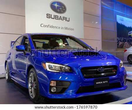 TORONTO-FEBRUARY 14: The all New 2015 Subaru WRX STi with a new 305HP engine at the 2014 Canadian International Auto Show on February 14, 2014 in Toronto           - stock photo